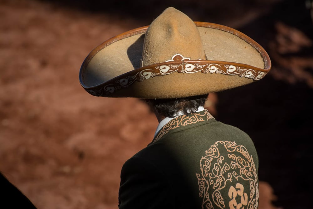 A cowboy's sombrero and traditional charro dress.