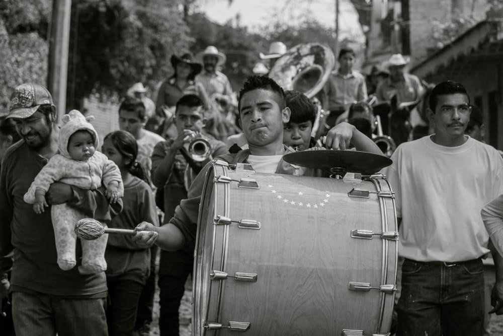 A banda in Mexico playing music during a Carnaval parade.