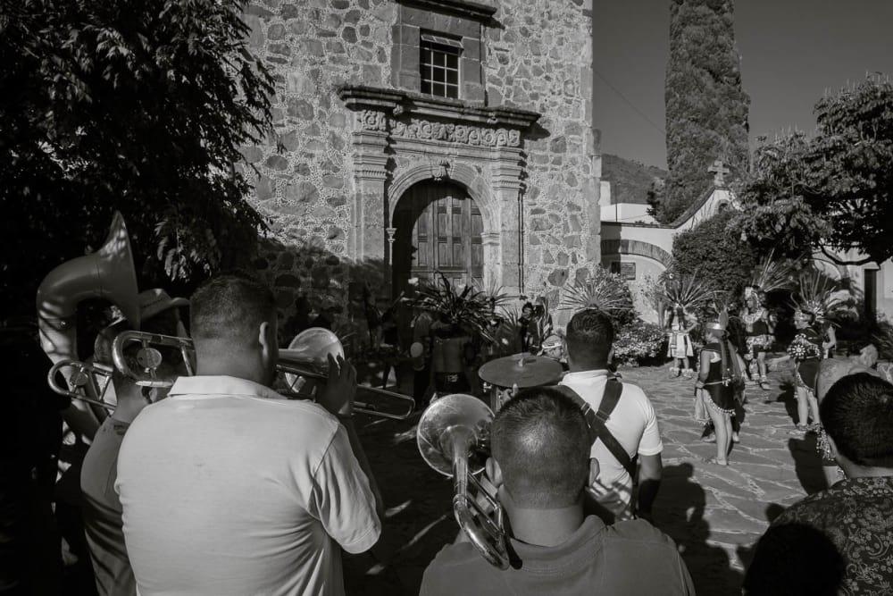 Banda and Aztec dancers during a procession for San Sebastián in Ajijic.