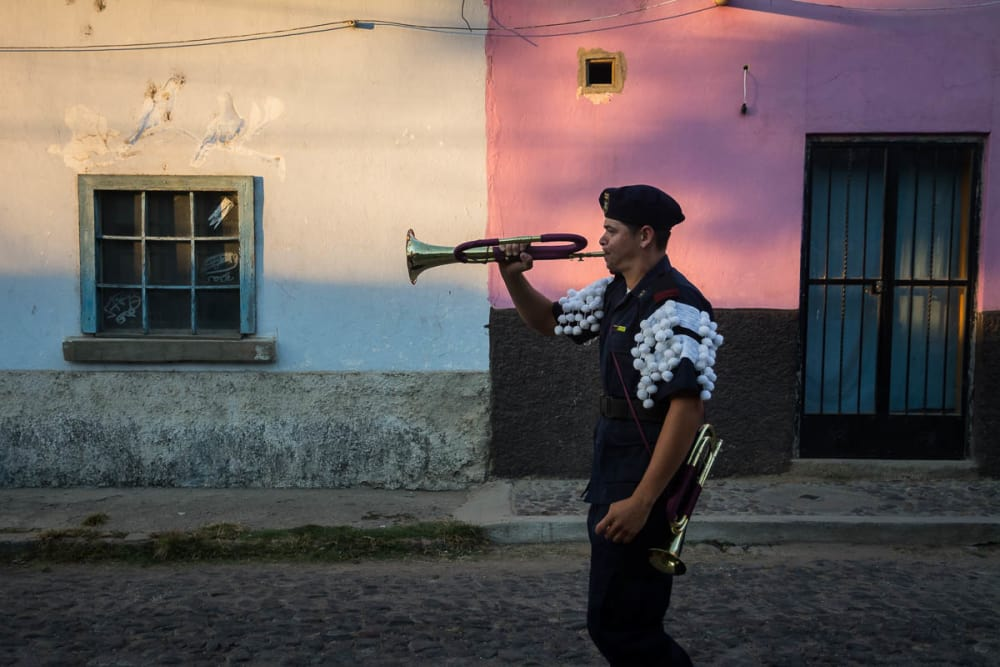 A bugle player during a parade in Mexico.