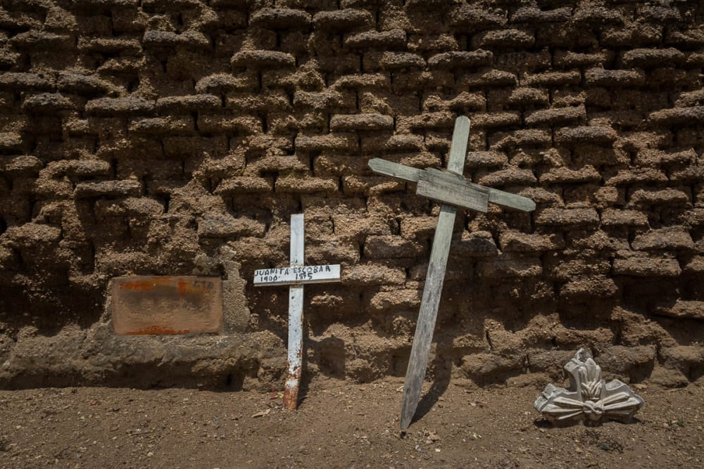 Crosses against an adobe wall in Tlaquepaque, Jalisco.