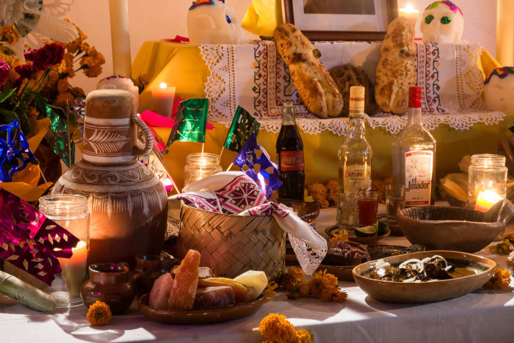 Alcohol and other offerings on a Day of the Dead altar in Ixtlahuacán de los Membrillos, Jalisco.