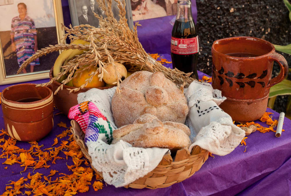 Pan de Muertos on a day of the dead altar on the Day of the Dead in Ajijic, Jalisco, Mexico
