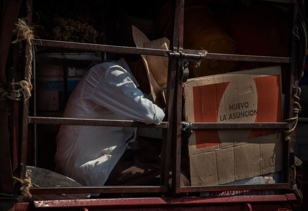 A man rides in the back of a truck in Guadalajara, Jalisco, Mexico.
