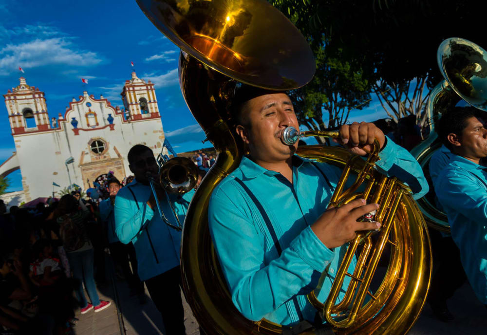 Banda playing in procession for Fiesta de la Sangre Preciosa del Cristo in Teotitlán del Valle, Oaxaca, Mexico.
