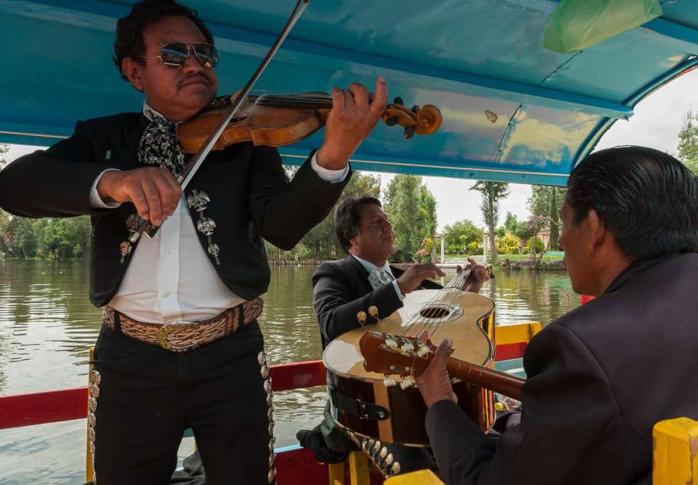 Mariachi musicians playing music at Xochimilco.