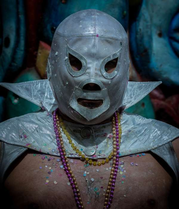 """""""Churro"""" wears a Mexican wrestling mask while performing as the joker during the 2016 Carnaval festivities in Ajijic, Mexico."""