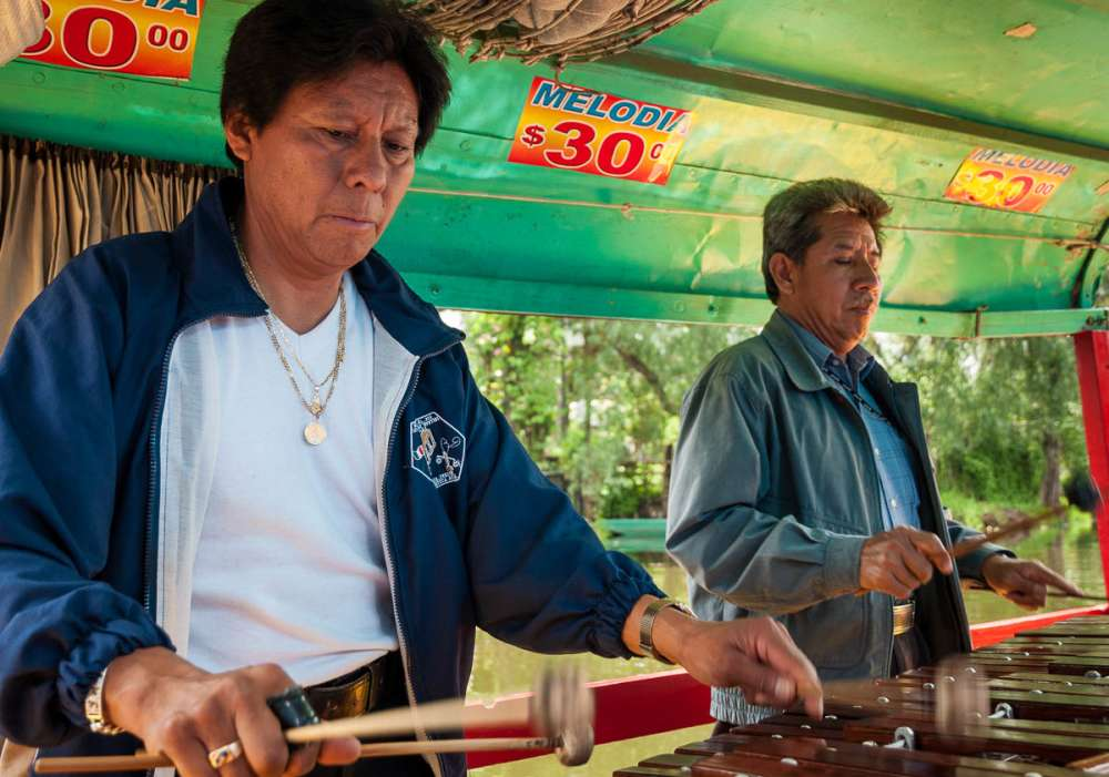 Musicians at Xochimilco in Mexico City play the marimba.