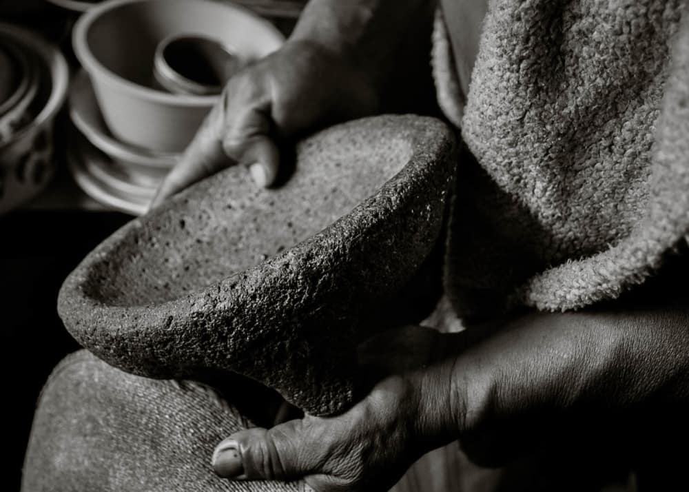 Ismael Sánchez holds a molcajete in his kitchen in Ajijic, Jalisco.