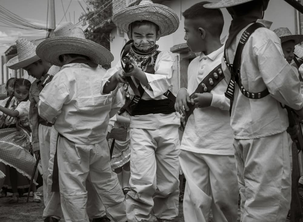 Kids dressed as heroes of the Mexican Revolution during Revolution Day in Ajijic.