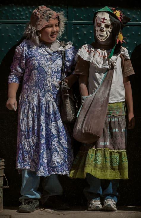 Two kids dressed as zayacas take a quick break during Carnival in Ajijic, Mexico.
