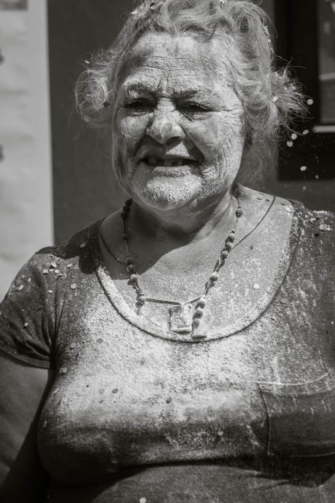 A woman covered in flour.
