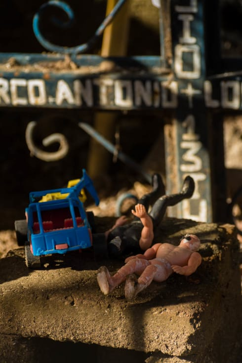 Toys left on a grave on the Day of the Dead in Ajijic, Jalisco. November 1 is called Día de los Angelitos and families build altars in the afternoon for deceased children in the family.