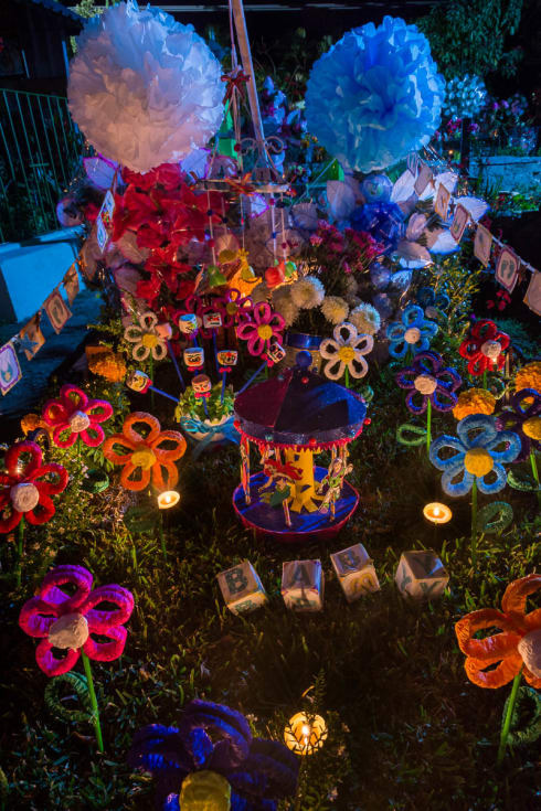 Handmade decorations light up an altar for a baby on a tomb in the Ajijic, Jalisco, graveyard.