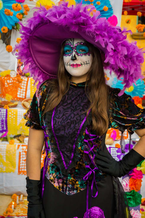 A young woman painted as a catrina on the Day of the Dead in Chapala, Jalisco, Mexico.