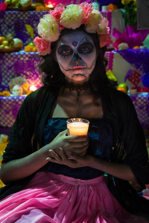A catrina holds a candle on the noche de muertos in Chapala, Jalisco.