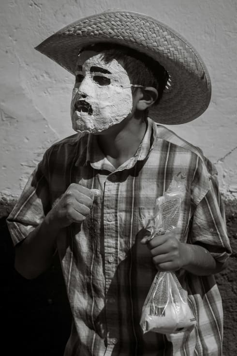 A zayaco with a bag of flour looking for someone to attack during Carnival celebrations in Ajijic.