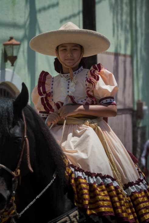 Gaby Gucho on her horse during the parade for el Día del Charro.