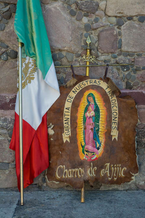 The Mexican flag and a banner for the charros of Ajijic.