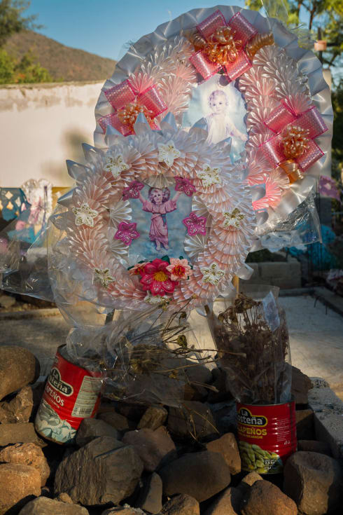 Grave with rocks and coronas in Mezcala, Jalisco.