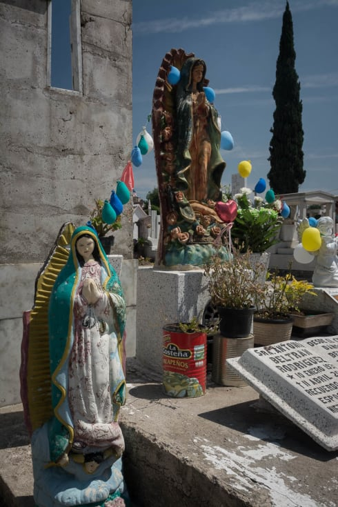 A grave with the Virgin of Guadalupe in Santa Anita, Jalisco.