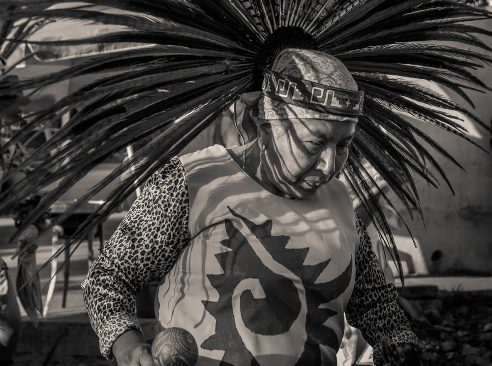 An Aztec dancer during the Fiesta for the Virgin of Rosario in Ajijic, Jalisco, Mexico.