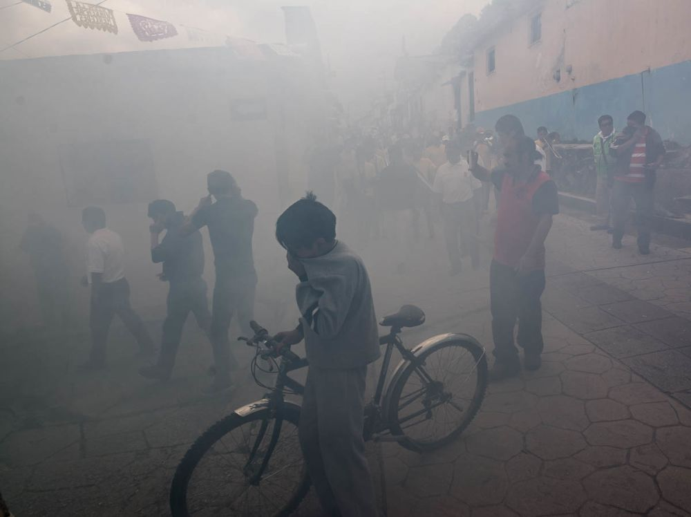 Bombas exploding during a procession for la Virgin de la Merced in San Cristóbal de las Casas, Chiapas, Mexico