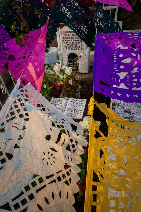 Papel picado hangs over a grave on November 1, 2010, in the Ajijic cemetery.