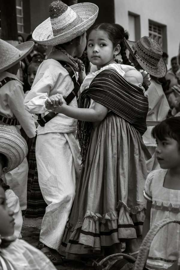 Kids dance in the street dresses as little Mexican revolutionaries on Revolution Day in Ajijic.