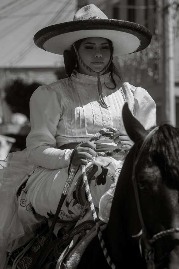 Anna Guitérrez, the quinceañera, riding her horse during the procession after the formal ceremony.