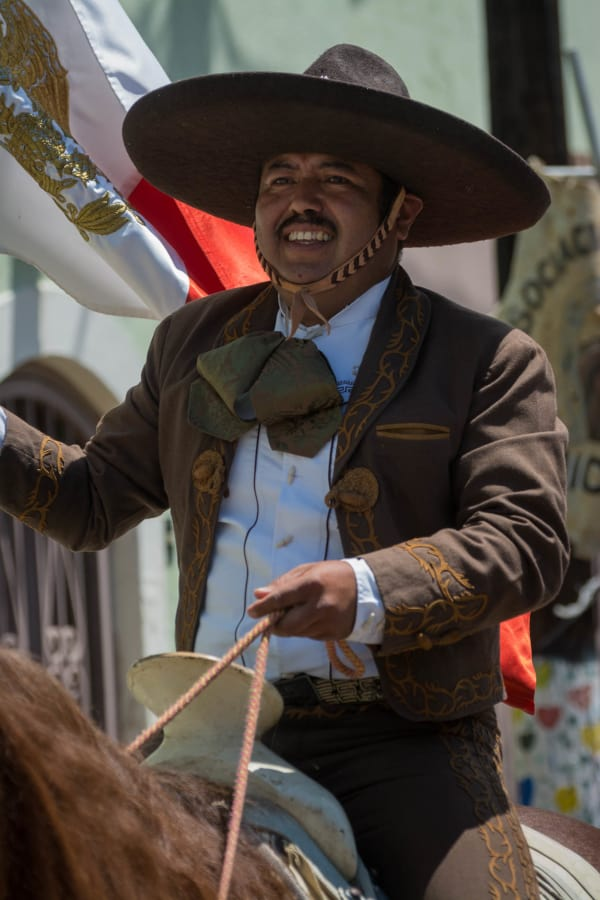 Juan Flores holds the Mexican flag during the parade.