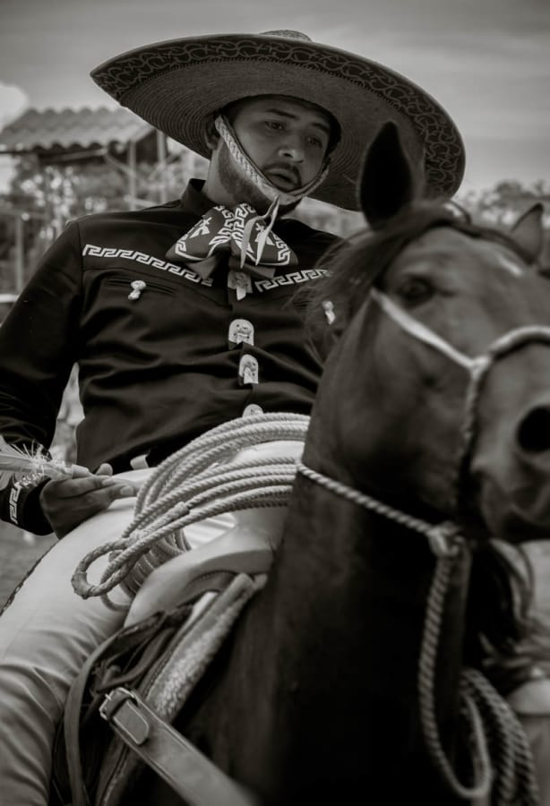 A cowboy plays a game of darts on horseback during the Day of the Cowboy.