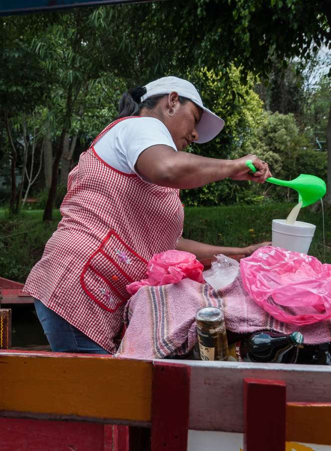 A woman serving pulque at Xochimilco, Mexico.
