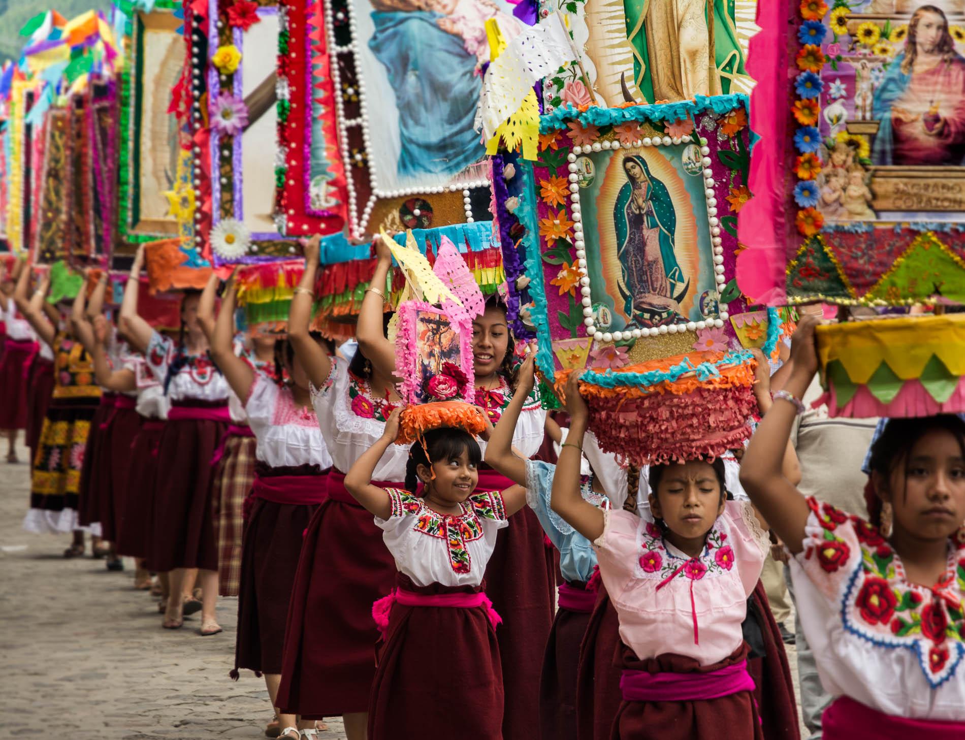 Hundreds of women take part in the procession for the fiesta of La Preciosa Sangre del Cristo in Teotitlán del Valle, Oaxaca, Mexico.