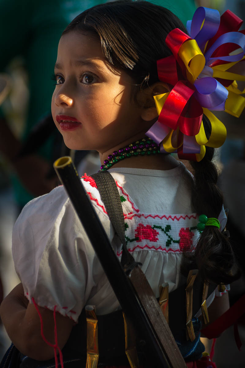 A soldadera, also known as adelita, takes part in the Revolution Day parade in San Antonio Tlayacapan, Jalisco, Mexico.