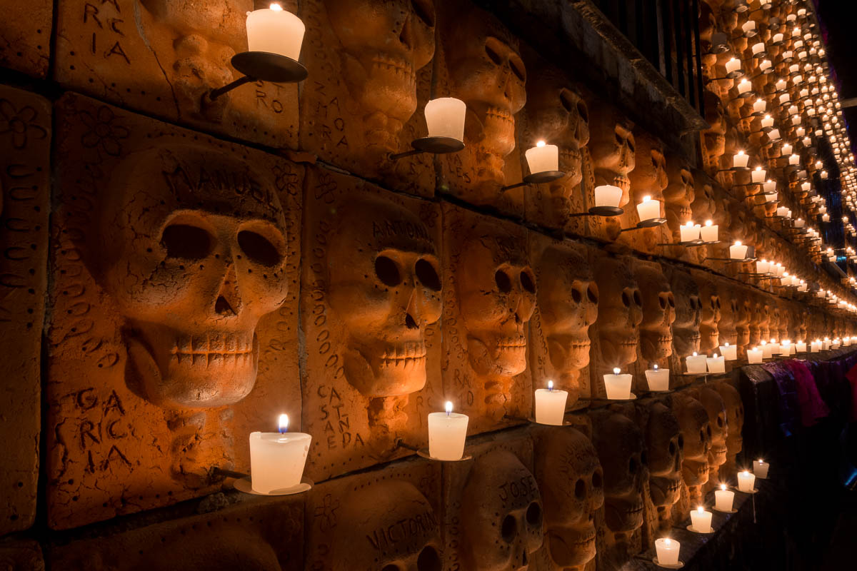 600 terracotta skulls are lit up by candles, each representing a deceased town or family member.