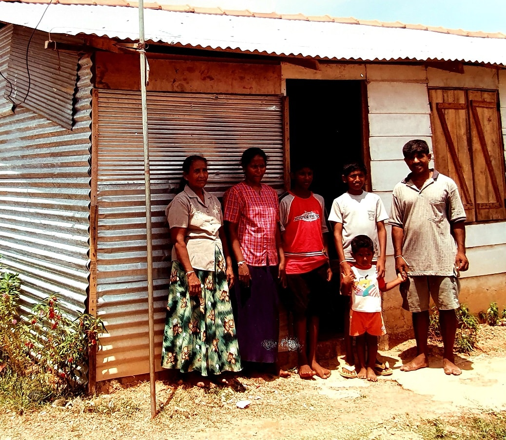 A family in Sri Lanka and their temporary accommodation
