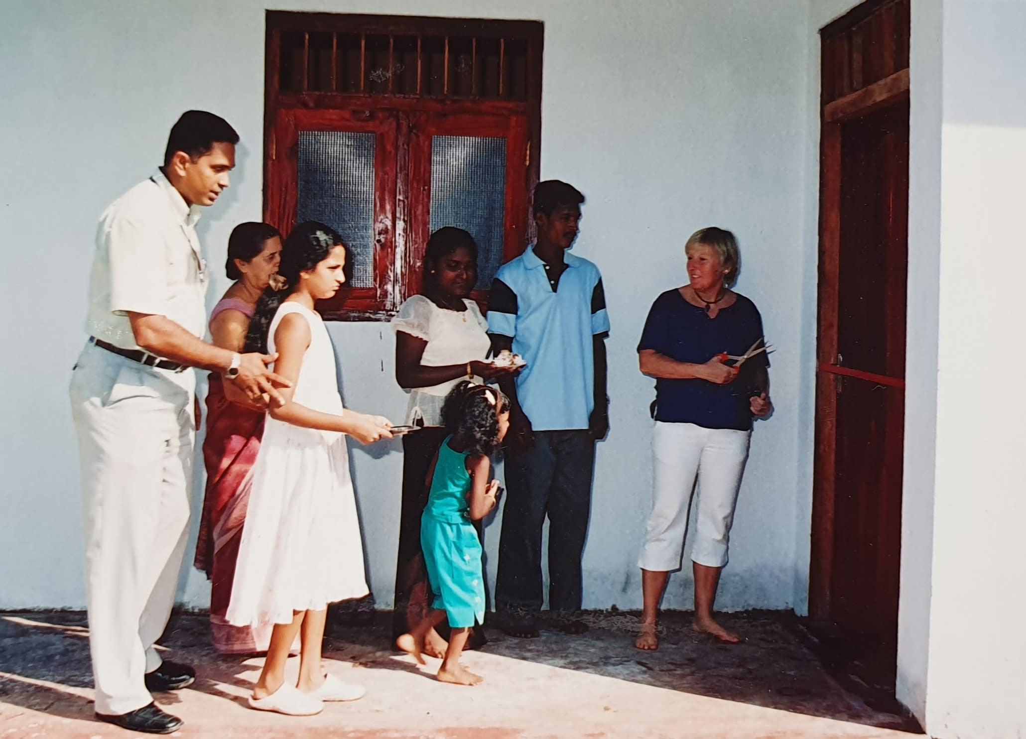 family in Sri Lanka receiving a new home
