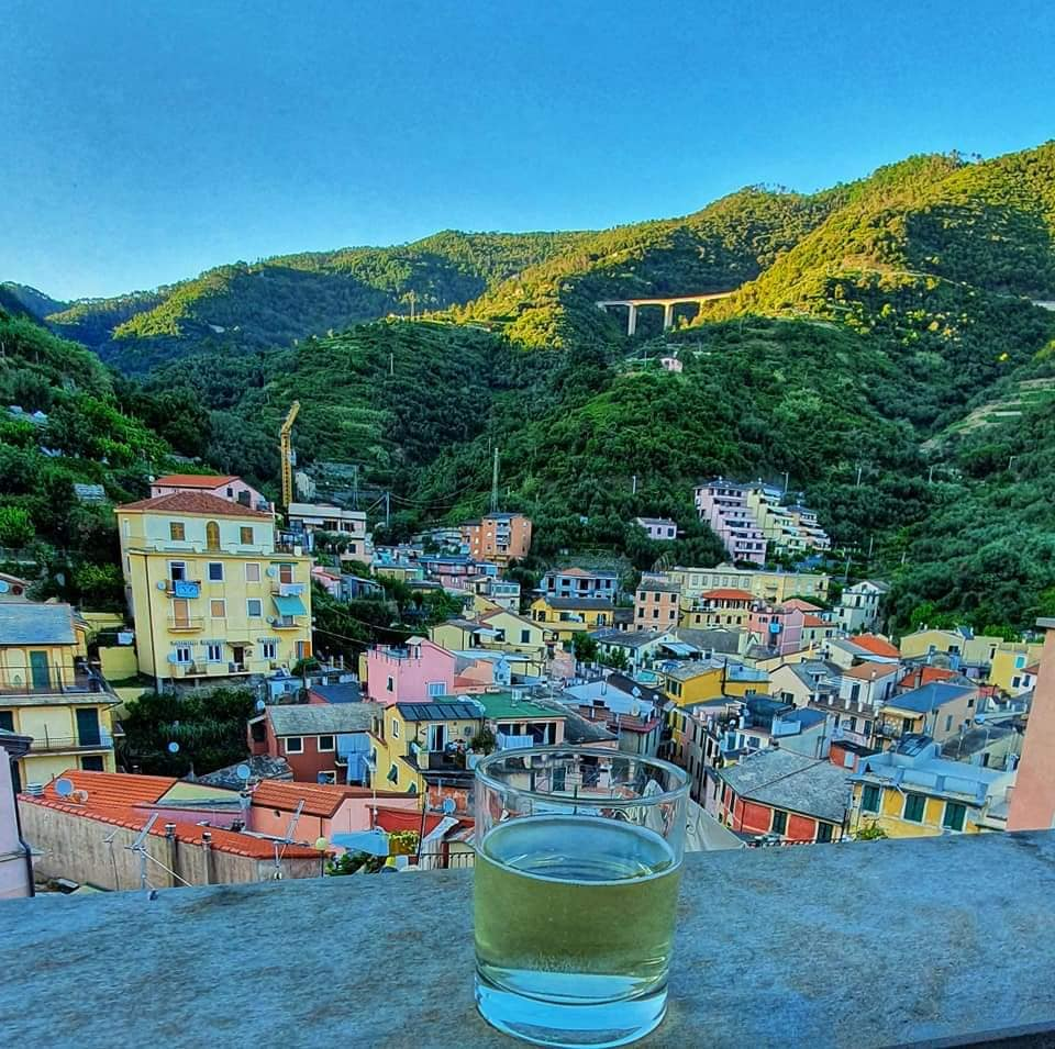 a glass of wine on the rooftop terrace