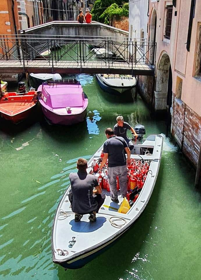 a visit to venice - firemen go by boat