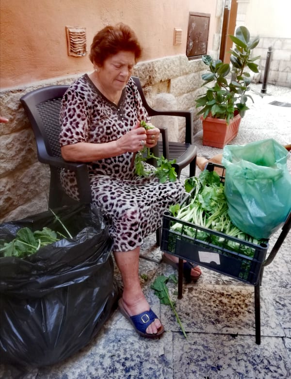 lady in Bari who provides broccoli flowers for local cafes and restaurants
