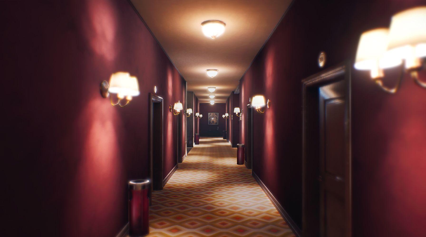 A well lit red hotel hallway