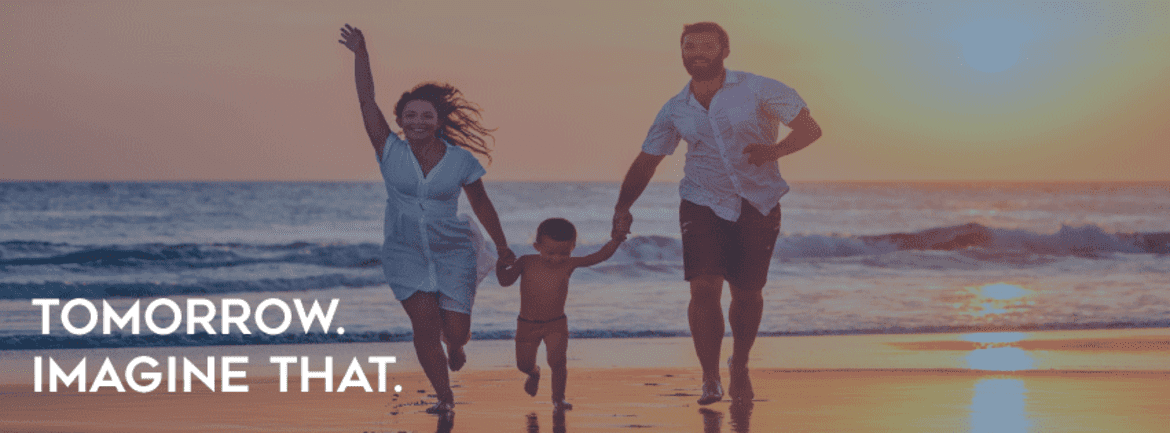 """A husband and wife running with a child on the beach. Caption text: """"tomorrow imagine that"""""""