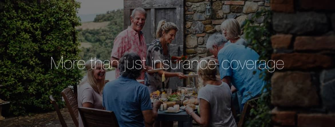 pure insurance banner image showing family enjoying company around an outdoor table