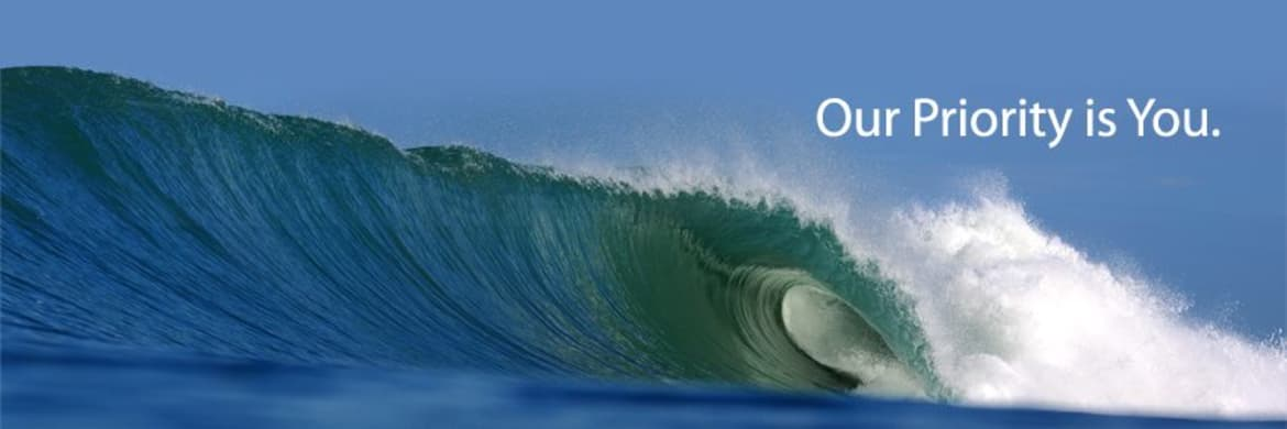 Large crashing ocean wave - Caption Text: Our Priority is You.
