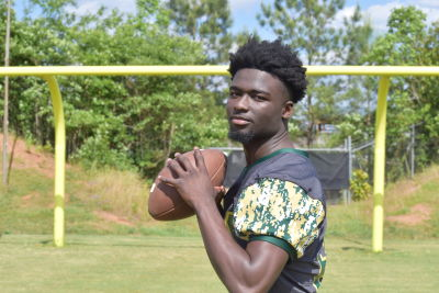 Bishop plays quarterback among many positions for his high school team. But he's not looking to do that on Saturdays. Except at Auburn. (Jeff Sentell / AJC)
