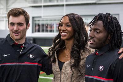 Jake Fromm (left) and Richard LeCounte with ESPN's Maria Taylor. (John Paul Van Wert / UGA)