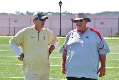 Mike Bobo (left) and Jim Chaney, past and present Georgia offensive coordinators. (ROB SAYE).