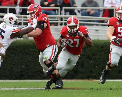 Nick Chubb finally got back over the 100-yard mark against Auburn. (Andy Harrison / UGA)