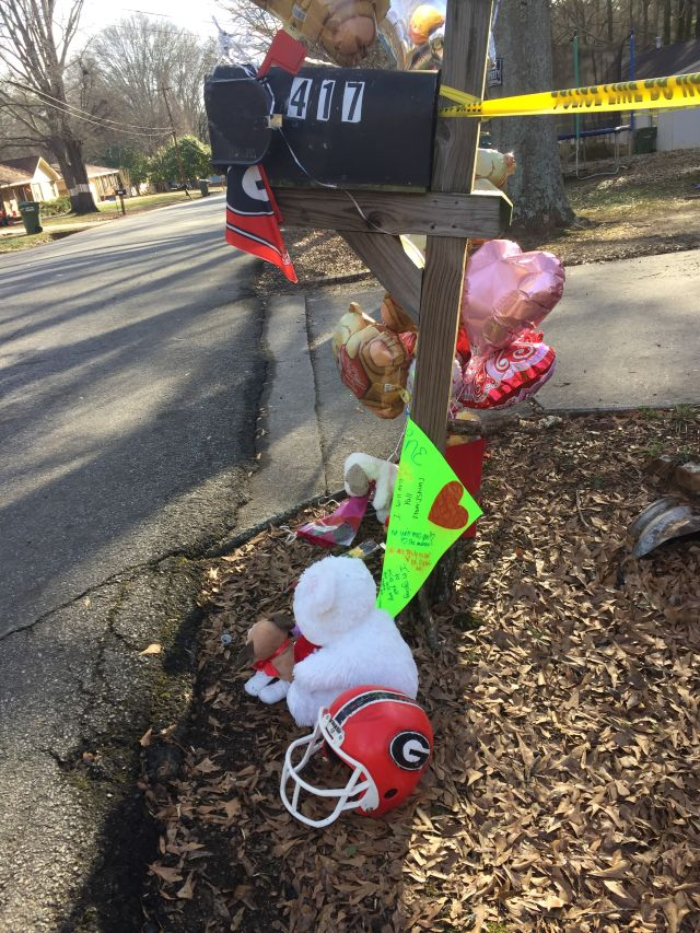 A small memorial was set up outside the house in which Quentin Moses was killed due to a fire on Saturday night. (SETH EMERSON/DAWGNATION)